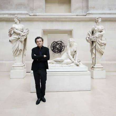 """Jean-Michel Othoniel in front of his installation """" La Rose du Louvre"""", in the Louvre Museum, 2019"""